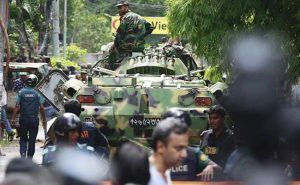 Armored personnel carriers prepare to deploy at Holey Artisan Bakery, Dhaka (photo: NDTV)